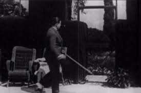 EASY VIRTUE (1928) Twenty one minutes in, Alfred Hitchcock walks past a  tennis court carrying a stick.   Hitchcock, Alfred hitchcock movies, Alfred  hitchcock